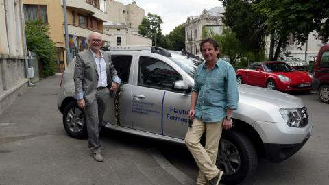Ion Bogdan Ştefănescu and Horia Mihail in front of their Dacia Duster